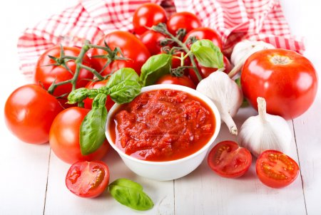 Photo for Tomato sauce with fresh vegetables on wooden table - Royalty Free Image