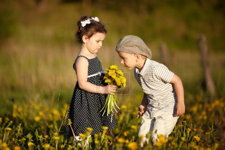cute boy and girl on summer field