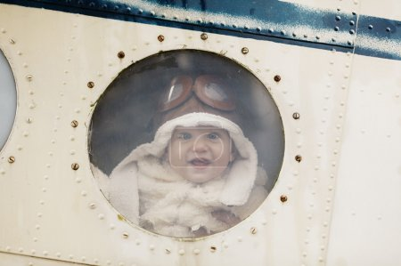 little baby dreaming of being pilot