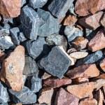 Rail road track ballast stone gravel close-up as b...