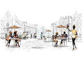 Series of street cafes in the old city with a musician a waitress and people at the cafe tables