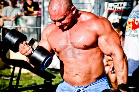 Photo for SIOFOK - AUG 4: Kokeny Bela participate in Scitec Muscle Beach bodybuilding seminar on August 4, 2012 in Siofok, Hungary - Royalty Free Image
