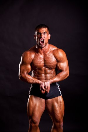 Photo for Young bodybuilder posing in studio - Royalty Free Image