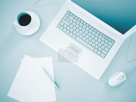 laptop documents and coffee as business background