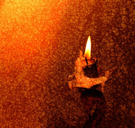 Photo for Close up of Candle with red background - Royalty Free Image