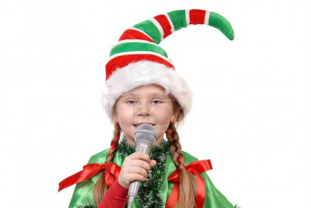 Photo pour Girl - Santa's elf with a microphone isolated on a white background - image libre de droit