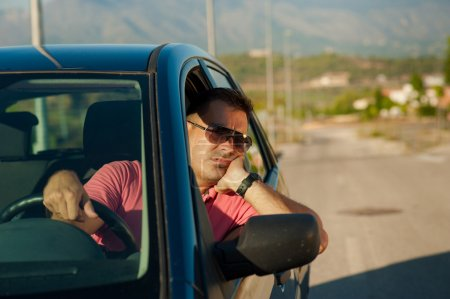 Photo for Guy pretty bored while waiting for an open road - Royalty Free Image