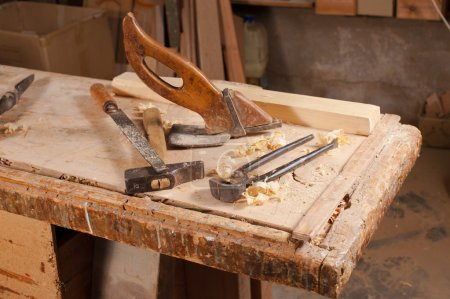 Photo for Old carpentry tools on a work bench - Royalty Free Image