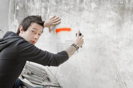 Photo for Graffiti artist about to start spraying a wall, looking at camera - Royalty Free Image