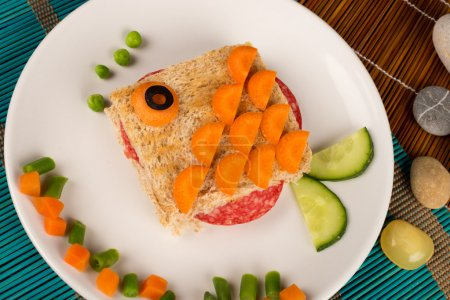Photo for A fish shaped sandwich, healthy kid food - Royalty Free Image