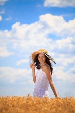 woman in field enjoying in summer day