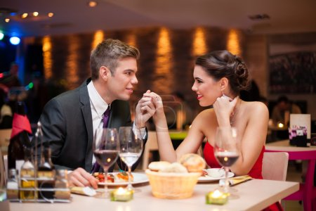couple flirting at restaurant