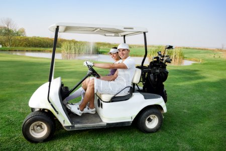 Couple in buggy in golf course