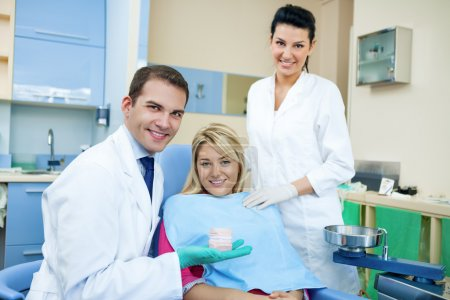 Dentist showing dental mold