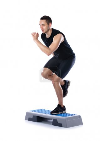 Young male doing step exercise