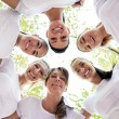 Group of women standing in the circle, smiling at ...