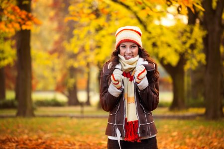Photo for Beautiful woman freezing in autumn park, cold autumn - Royalty Free Image