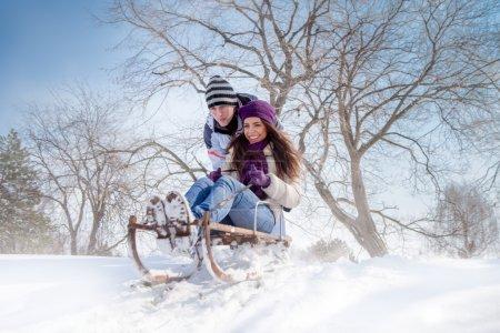 couple sledging through
