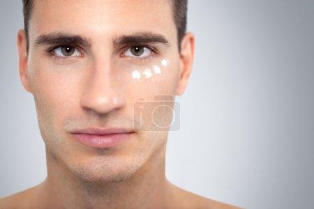 Cream on man's face