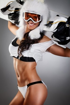 Seductive woman with snowboard