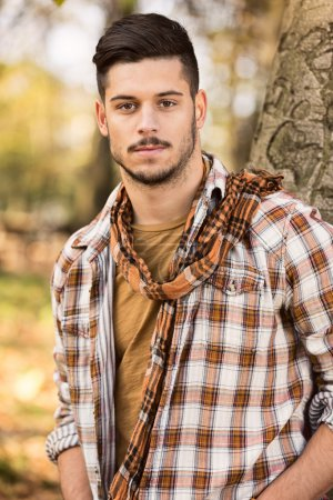 Young man in a checkered shirt