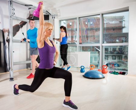 Sporty woman exercising at gym