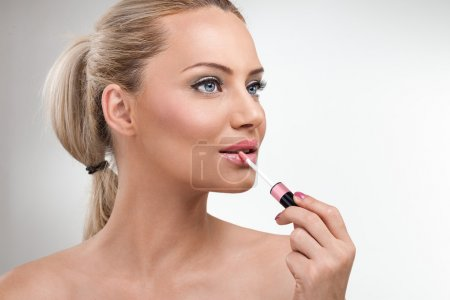 Woman with lip gloss