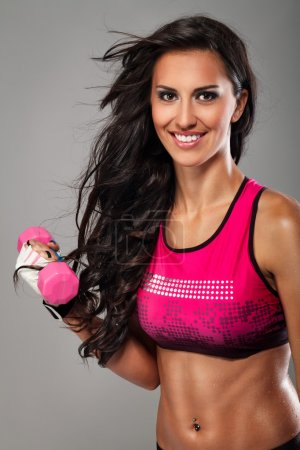 Fitness exercise woman with a dumbbell