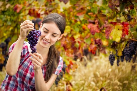 woman with  bunch grape