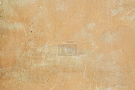 Old yellow stucco wall texture background...