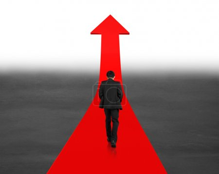 Man walking on going up red arrow