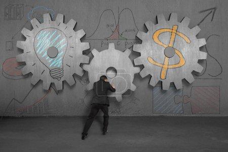 Assembling large gear for idea is money concept