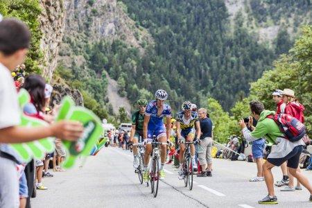 Alpe-D'Huez,France- July 18, 2013: Three cyclists ...