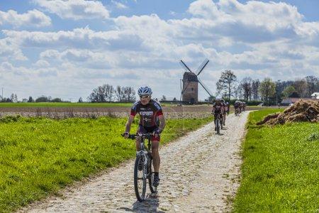 Amateur Cyclists on a Cobblestone Road
