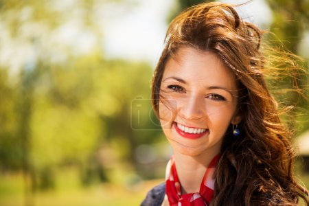 Photo for Portrait of Smiling Young Woman in The Nature with Summer Breeze in the Hair. - Royalty Free Image