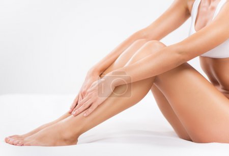 Photo for Bodycare of female Smooth legs. - Royalty Free Image