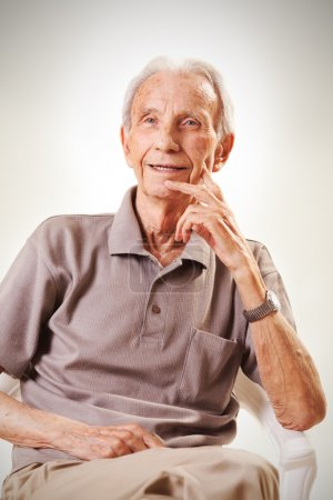 Photo for Elderly senior men sitting and remembering past - Royalty Free Image