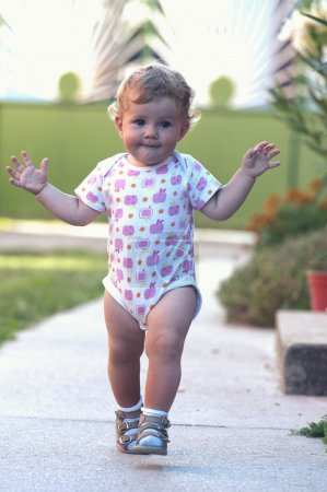 The first independent steps of a baby girl