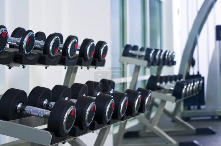 Fragment like view of gym interior with some dumbbells