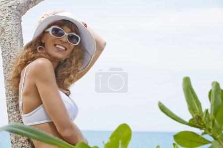 Portrait of beautiful girl having good time on tropical beach