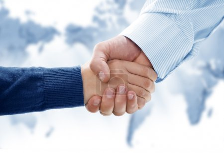 Close up view of business handshake in office environmeny