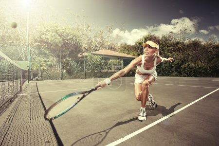 Photo for Portrait of young beautiful woman playing tennis in summer environment - Royalty Free Image