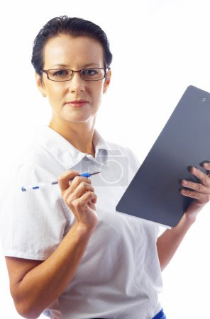Portrait of businesswoman in stylish glasses with clipboard on white back.