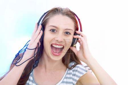 View of young female listening music via earphones. Image may contain slight multicolor aberration as a part of design.