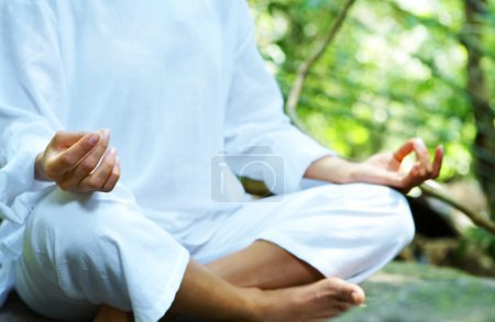 Photo for Image of young woman practicing yoga in tropic environment - Royalty Free Image