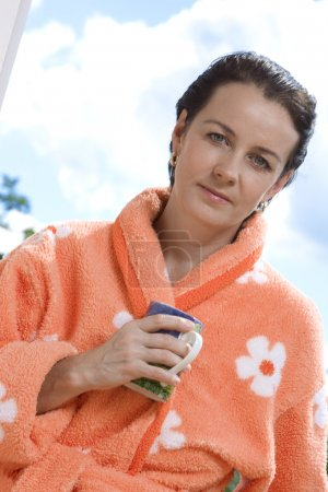 Portrait of nice brunette in summer environment