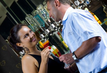 Photo for Portrait of young attractive couple having date in bar - Royalty Free Image