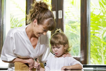 Portrait of beautiful young woman with her daughter
