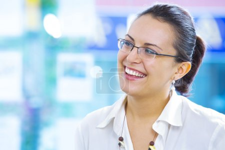 Portrait of young pretty woman in business environment