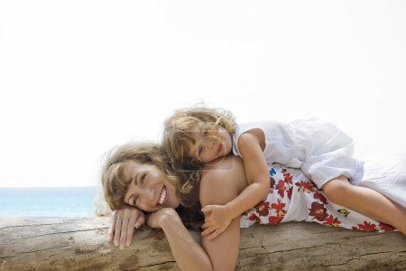 View of young woman having good time with her daughter